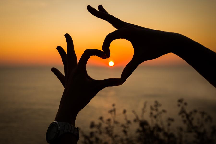 Hands sun heart spirit